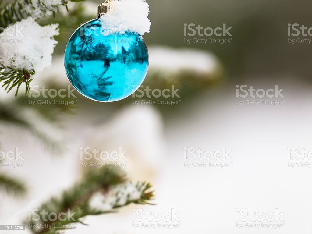 Shining Christmas ball with snow for card stock photo