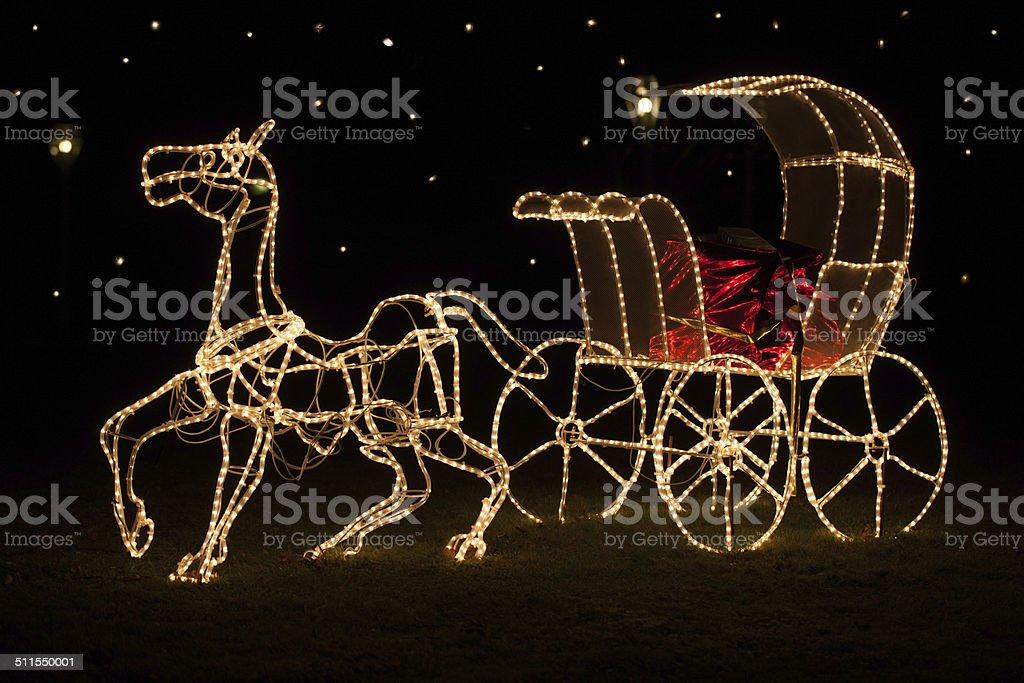 Shining Christmas horse-drawn carriage royalty-free stock photo