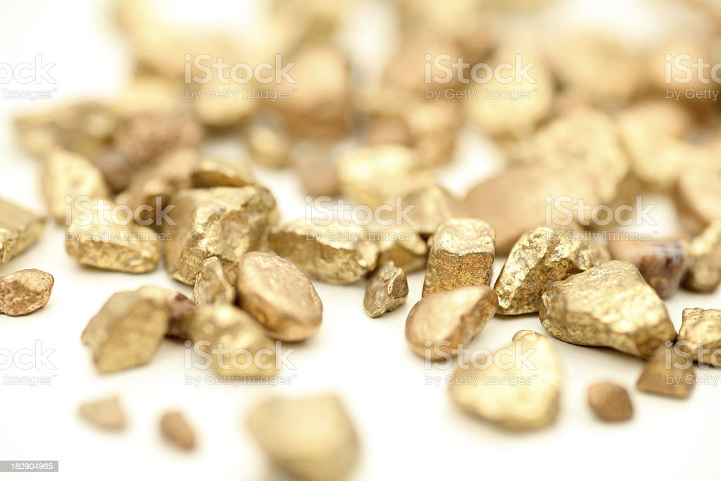 Shining gold nuggets, isolated on white stock photo