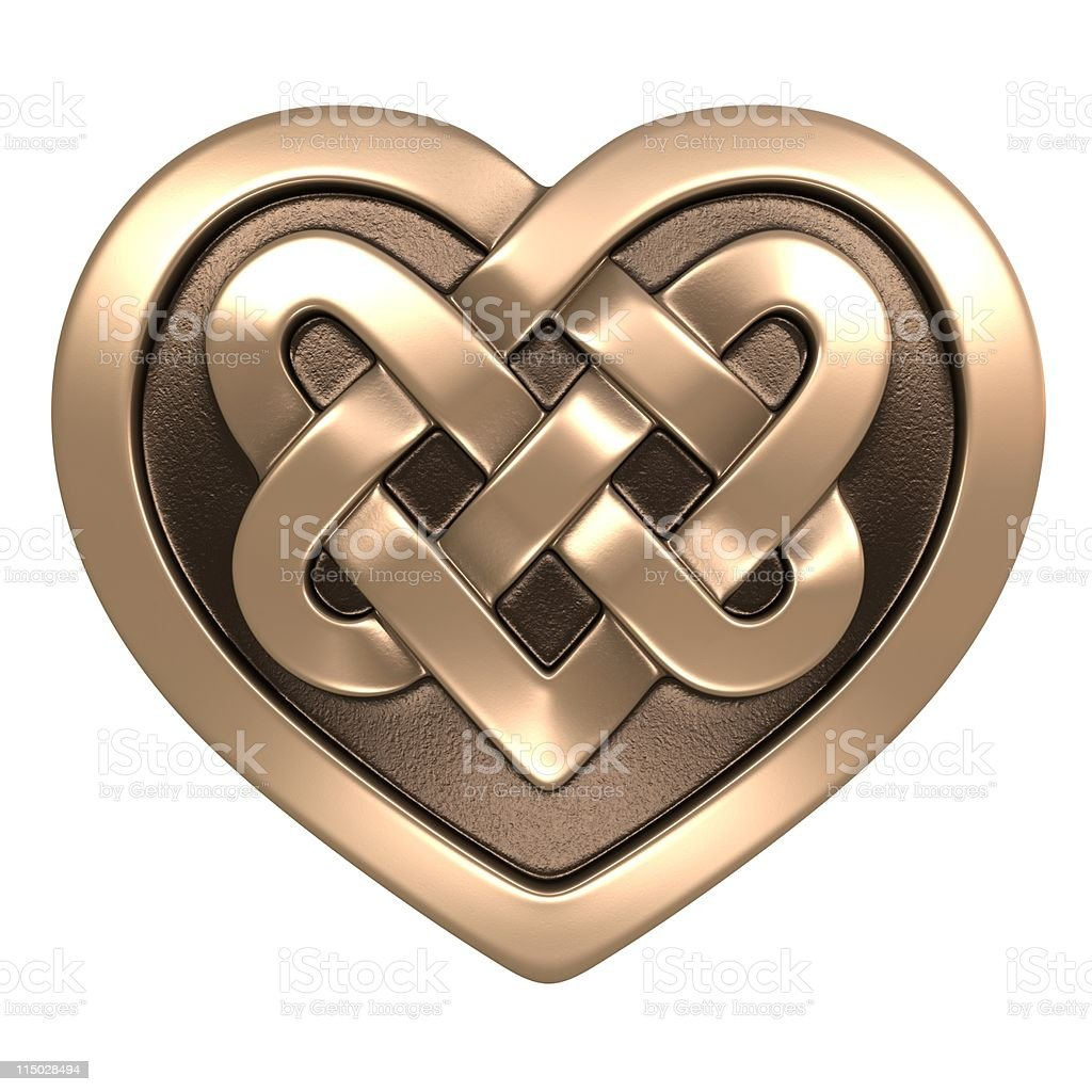 Shining golden Celtic heart on white background stock photo