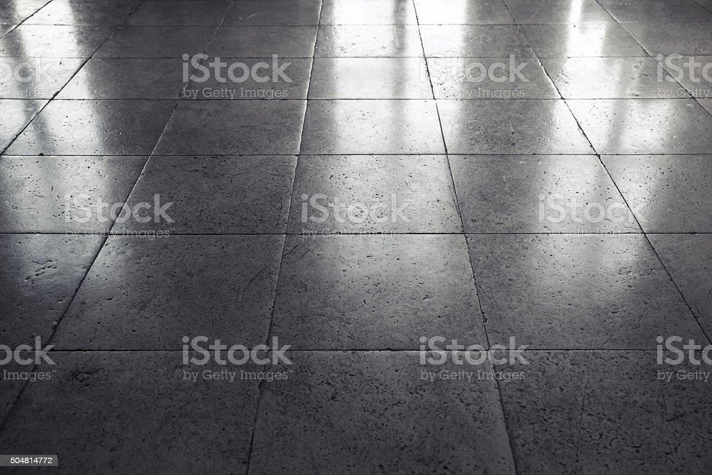 Shining gray stone floor tiling, background stock photo
