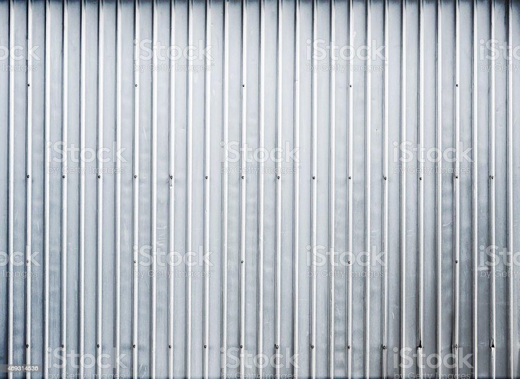 Shining ridged garage metal wall, background texture stock photo
