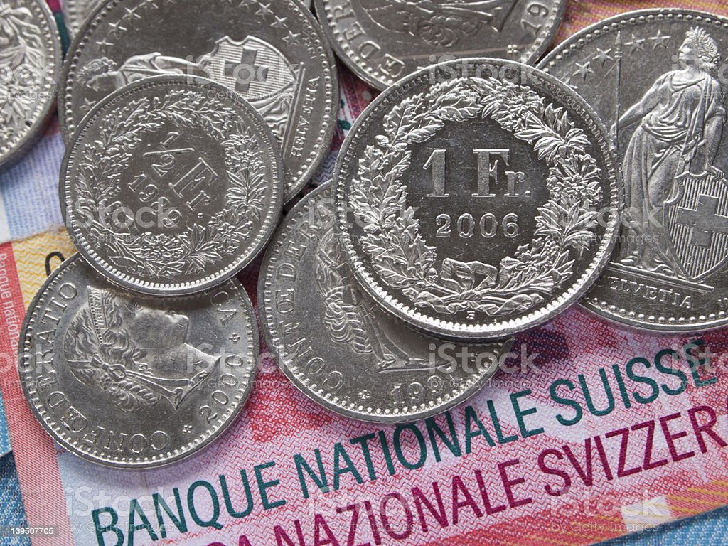 Shining Swiss Franc coins on 20 Swiss Franc bank notes stock photo