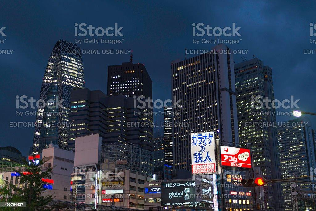 Shinjuku skyscrapers and neon banners at night stock photo