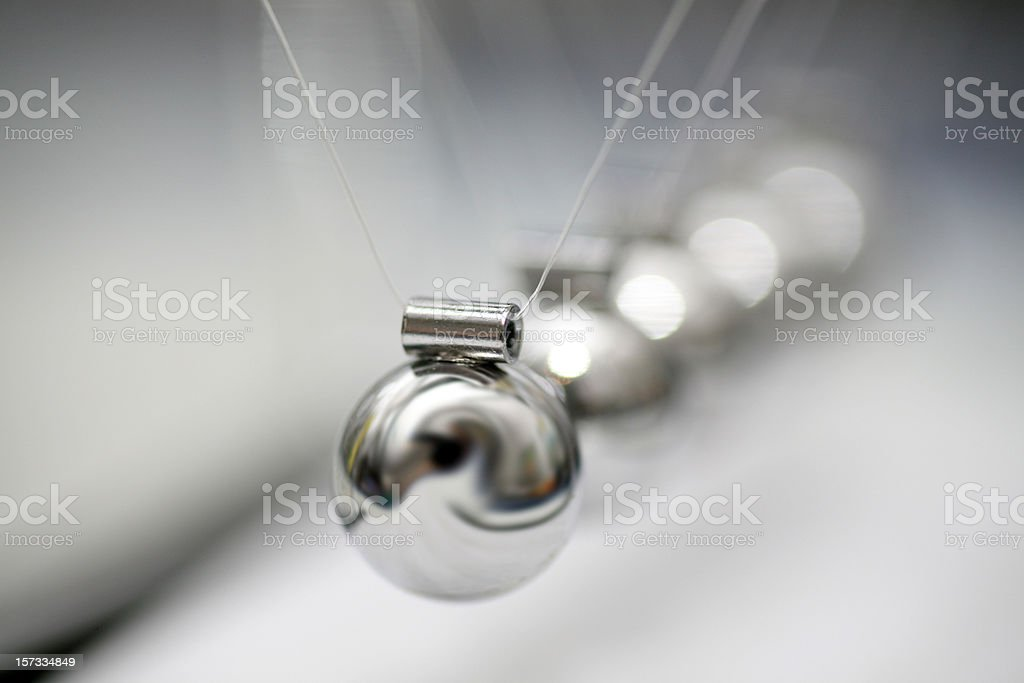 Shinny and metal newton's cradle stock photo