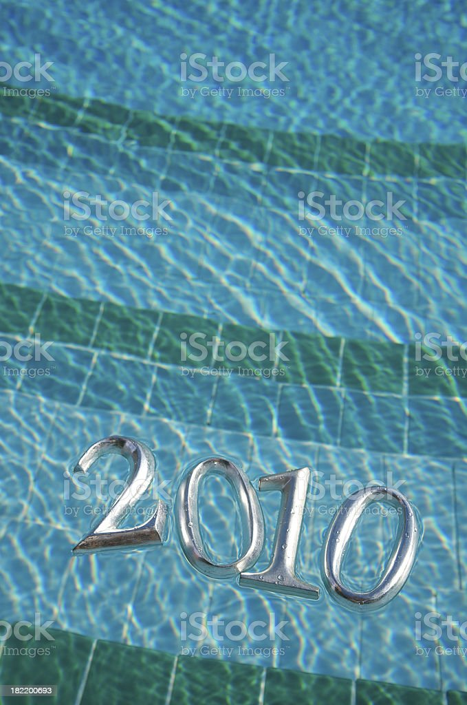 Shiny 2010 Message Floats on Pool Background royalty-free stock photo