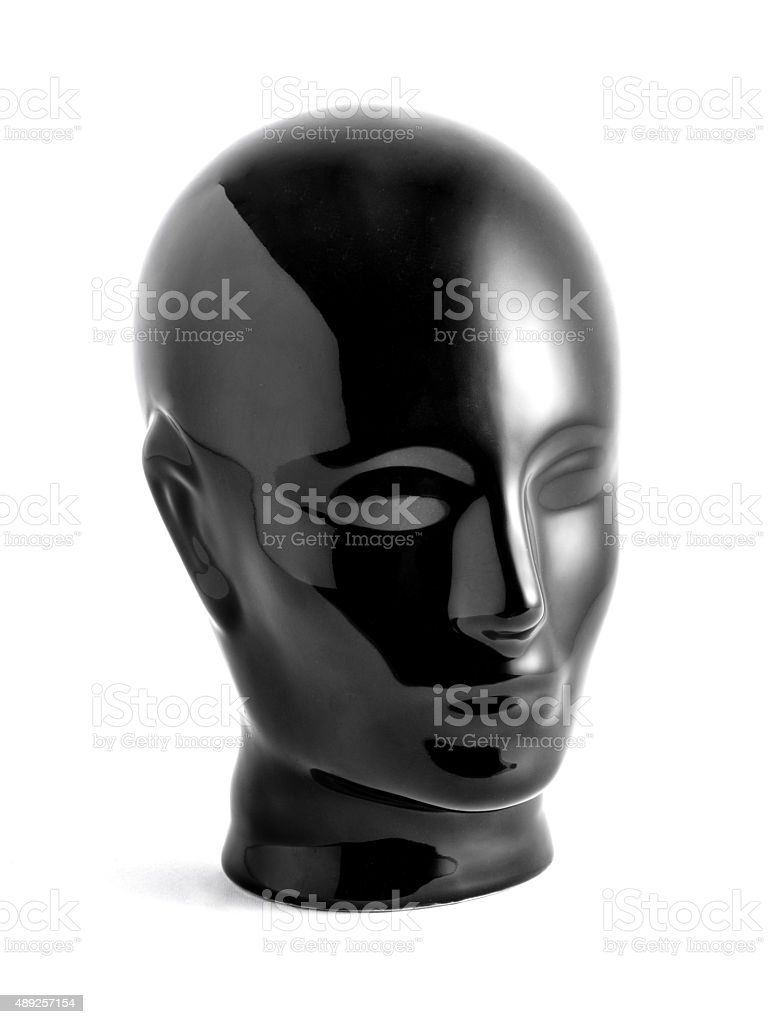 Shiny Black Mannequin Head on White Background stock photo