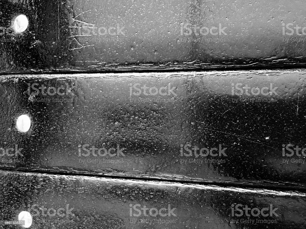 Shiny black wooden material with screws royalty-free stock photo