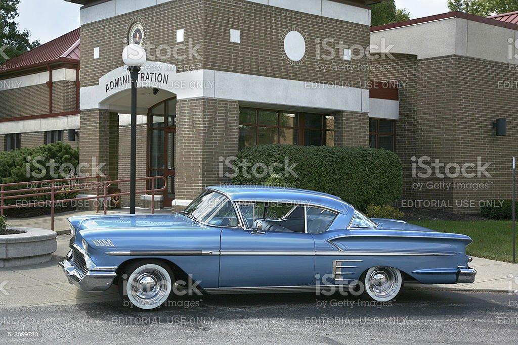 shiny blue 1958 impala parked outside stock photo