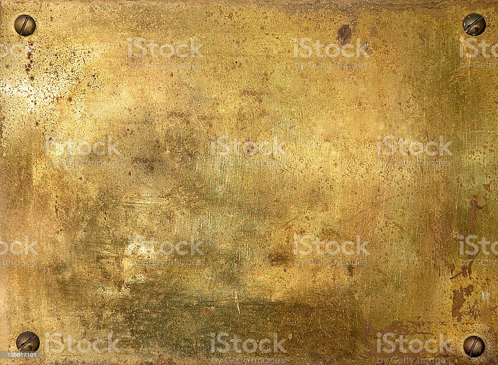 Shiny brass metal plate with screws stock photo
