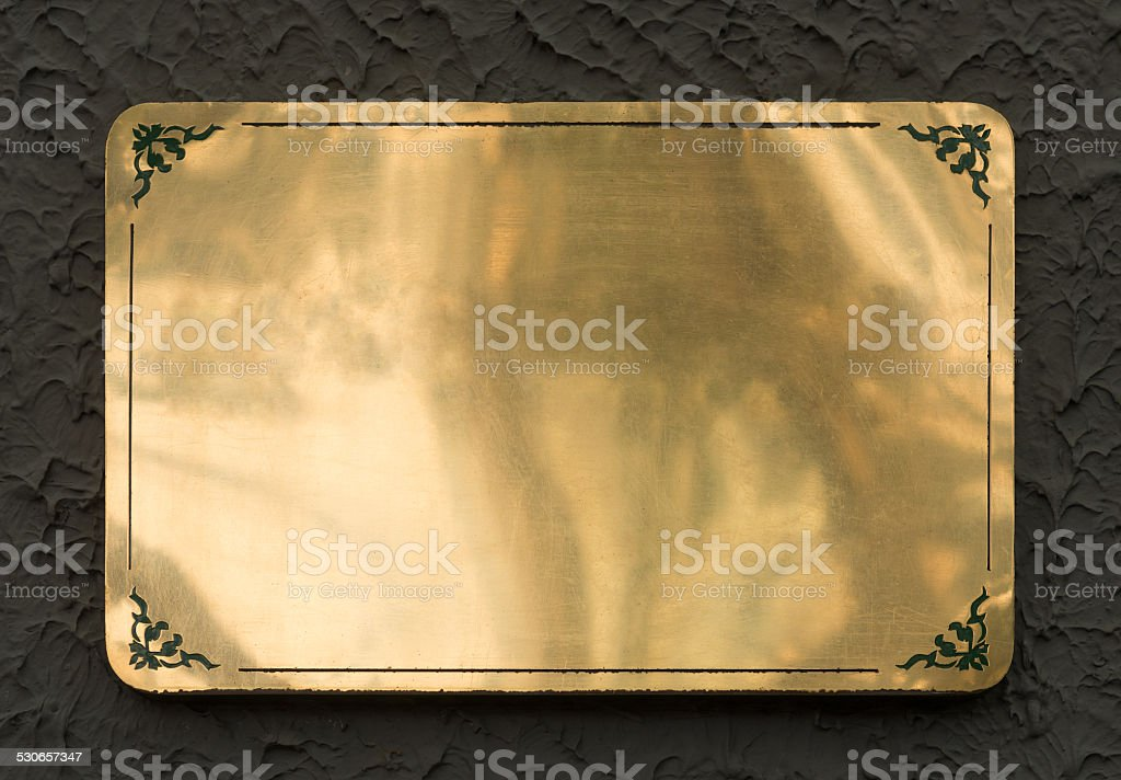 Shiny brass metal sign texture stock photo