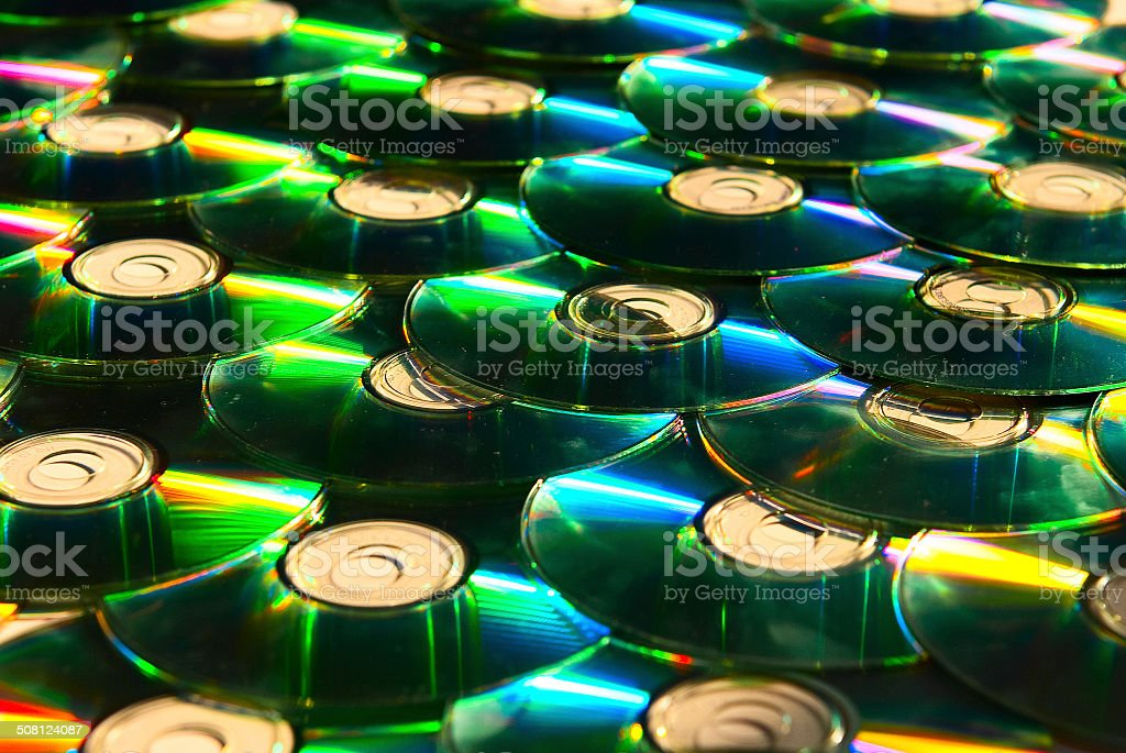 shiny cd discs lie on each other and shine stock photo
