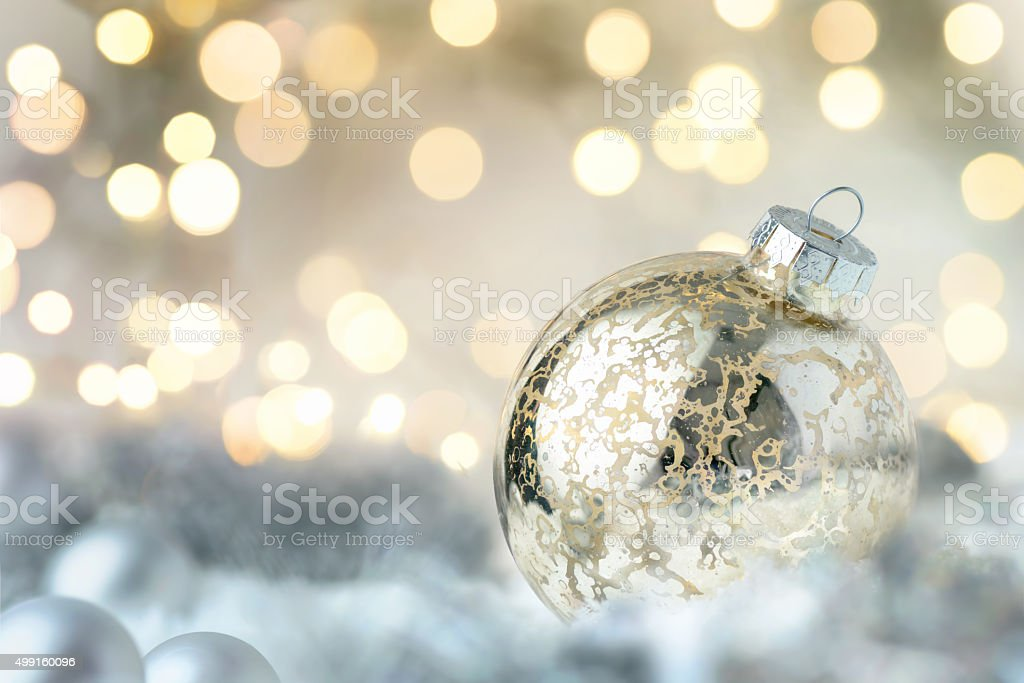 Shiny Christmas bauble and glittering lights stock photo