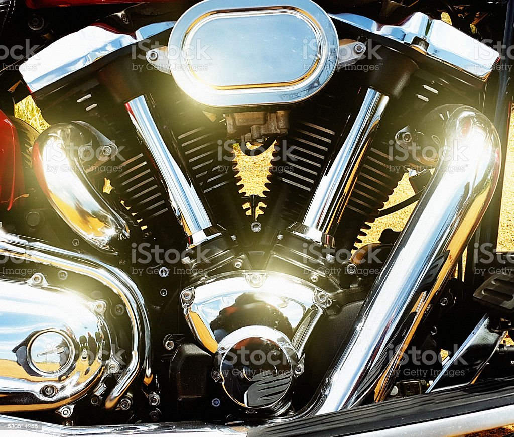 Shiny chrome pipes and parts of modern motorcycle stock photo