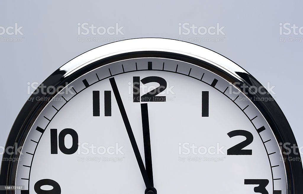 shiny clock hanging on the wall with copy space.Deadline concept royalty-free stock photo