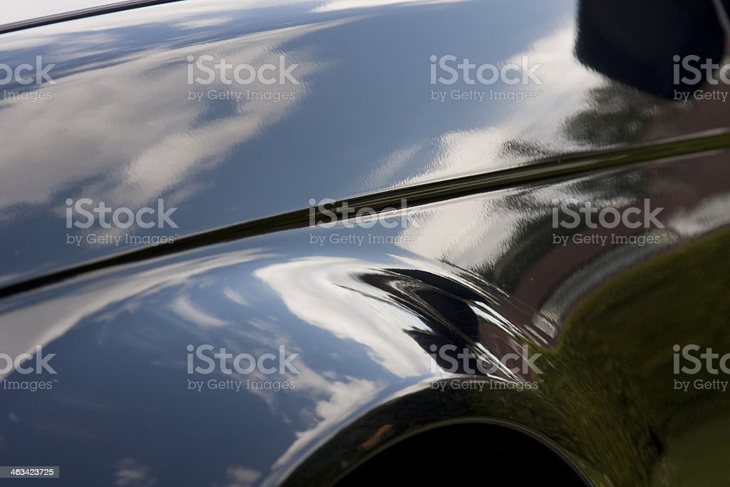 Shiny close-up of a vehicle which is reflecting the sky stock photo