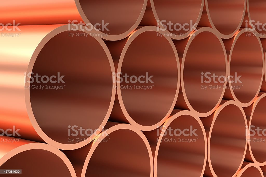 Shiny copper pipes in rows closeup stock photo