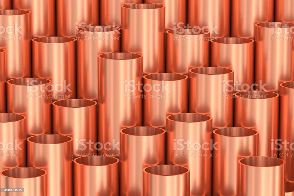 Shiny copper pipes industrial background stock photo