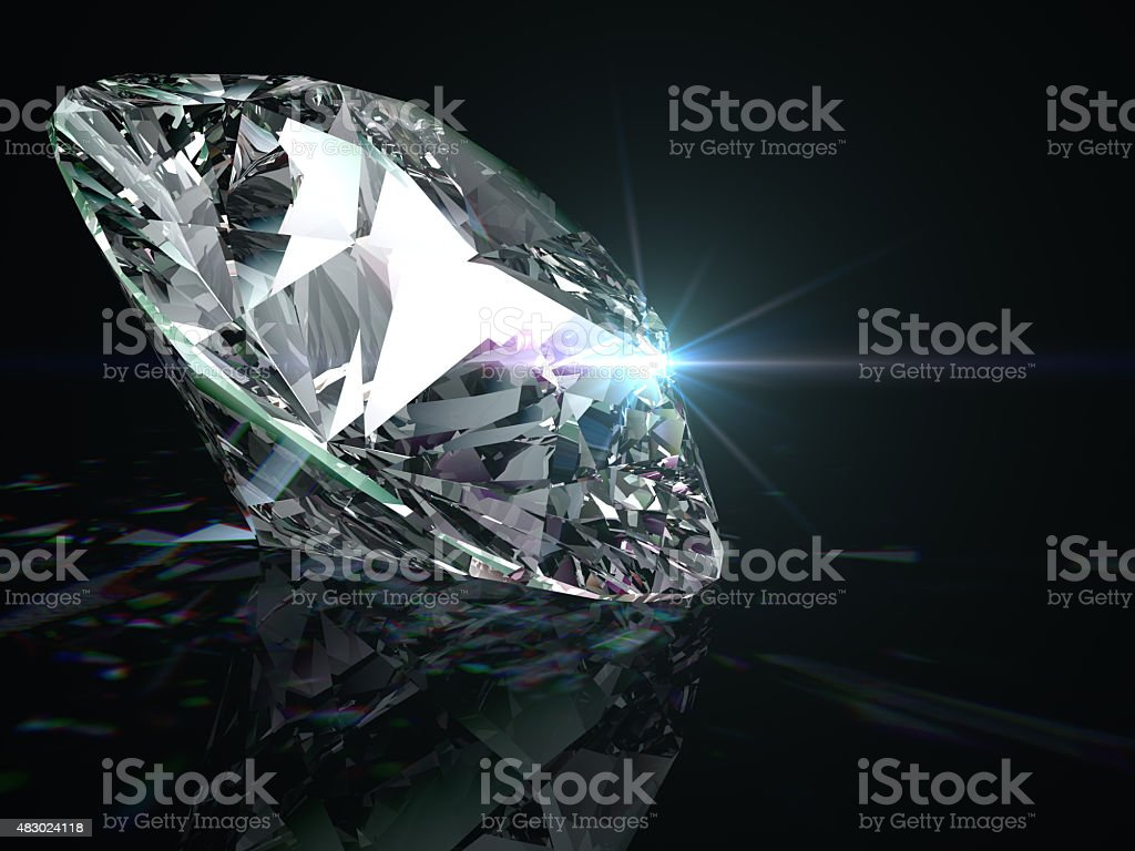 Shiny diamond on black background. stock photo