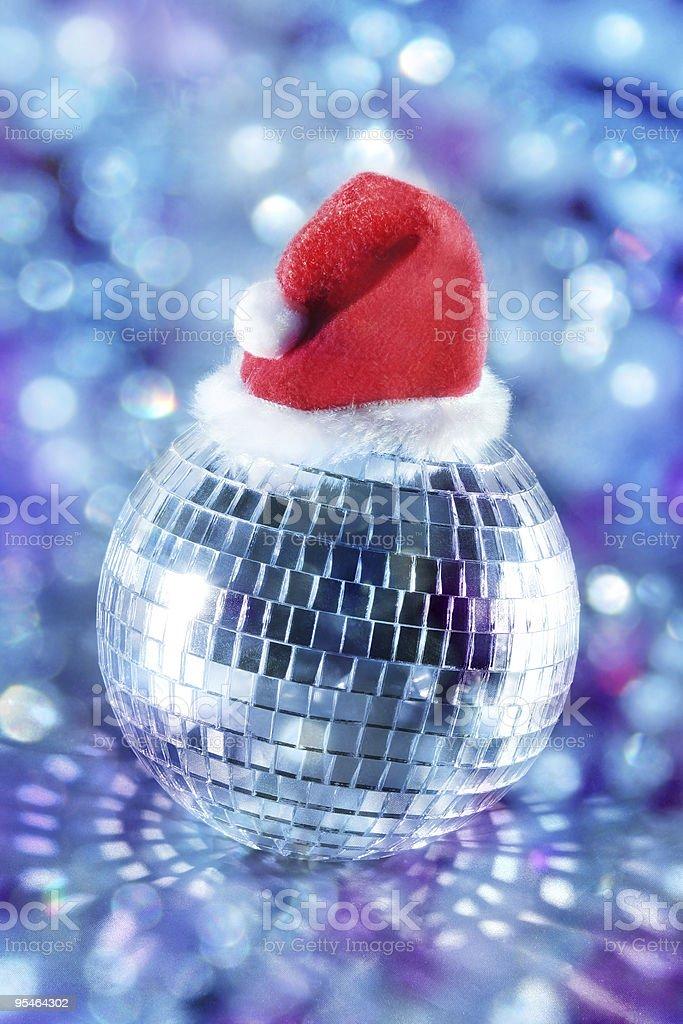 Shiny disco ball in santa hat royalty-free stock photo