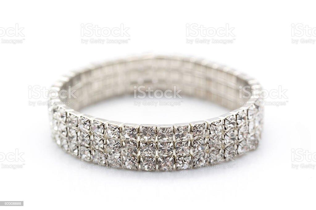 Shiny gem encrusted bracelet resting on its side stock photo