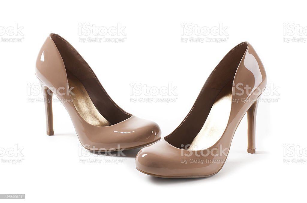 Shiny glamour light brown women's shoes stock photo