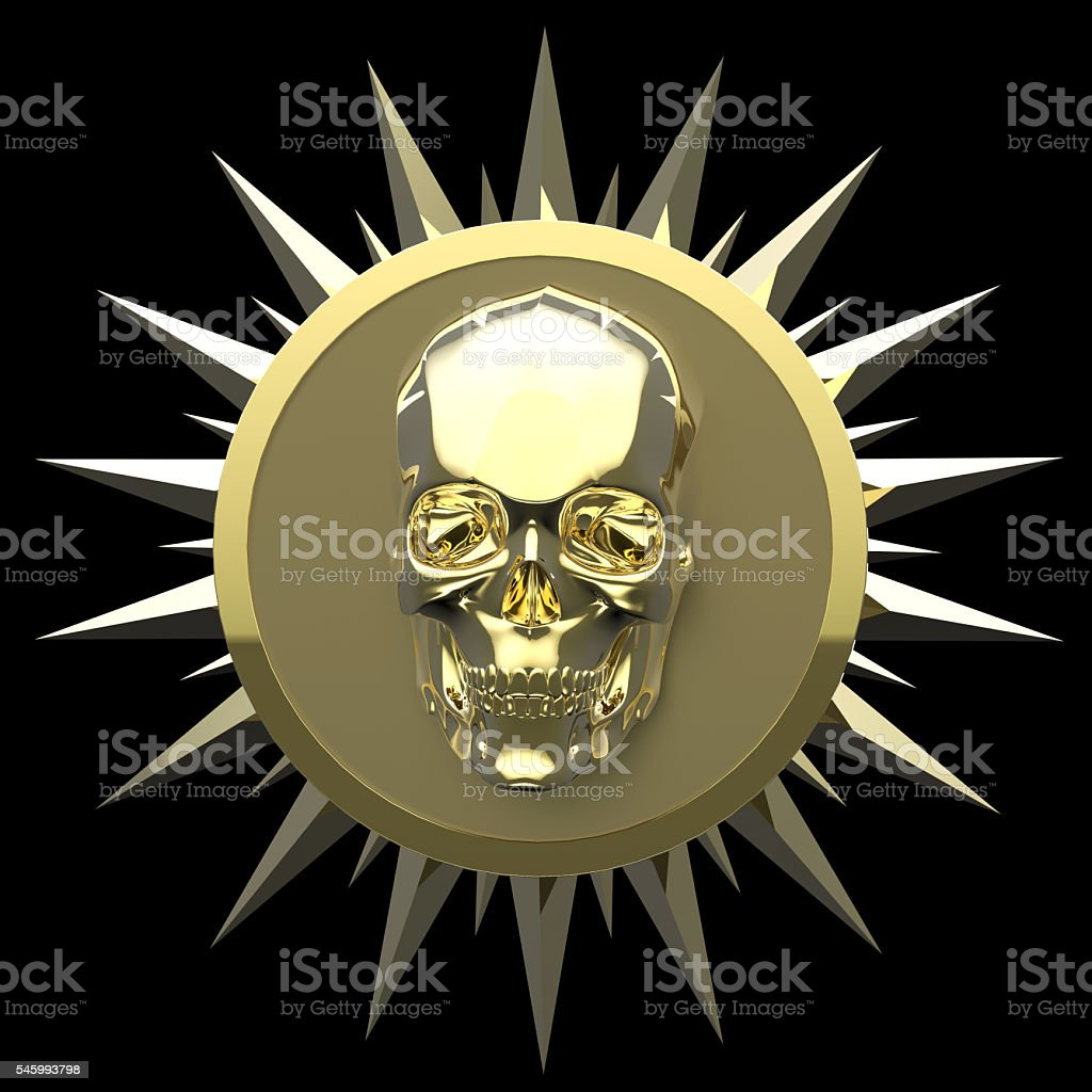 shiny gold metal skull on matte golden plate with   spikes stock photo