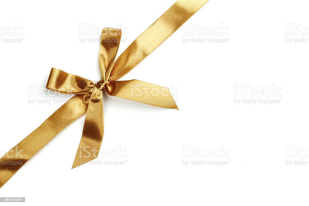 A shiny golden ribbon tied up in a bow stock photo