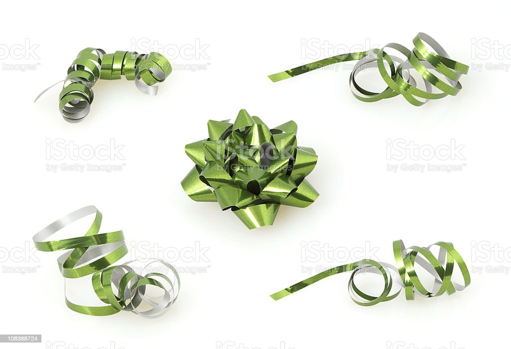 Shiny green bow and confeties stock photo