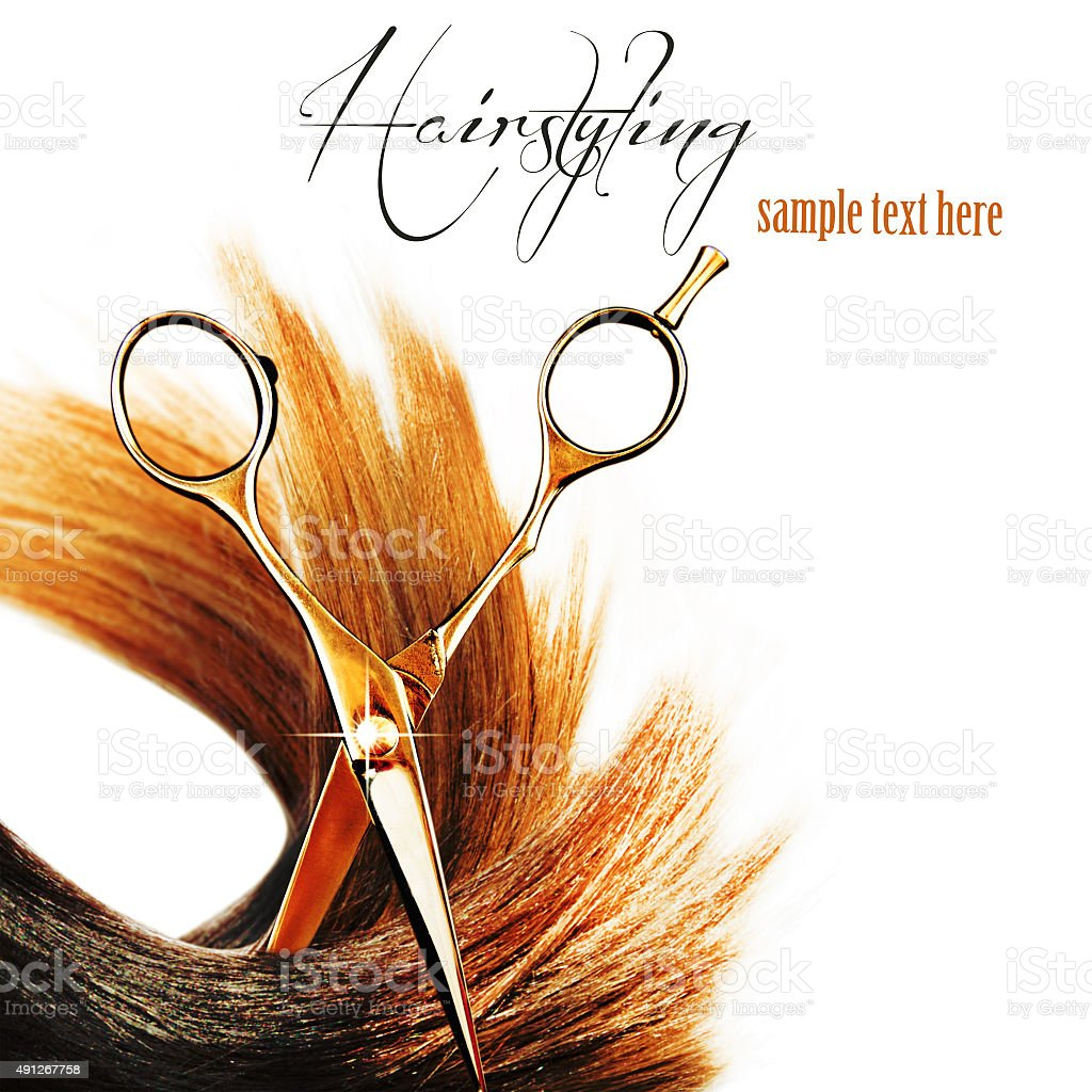 Shiny hair with professional scissors isolated on white. stock photo