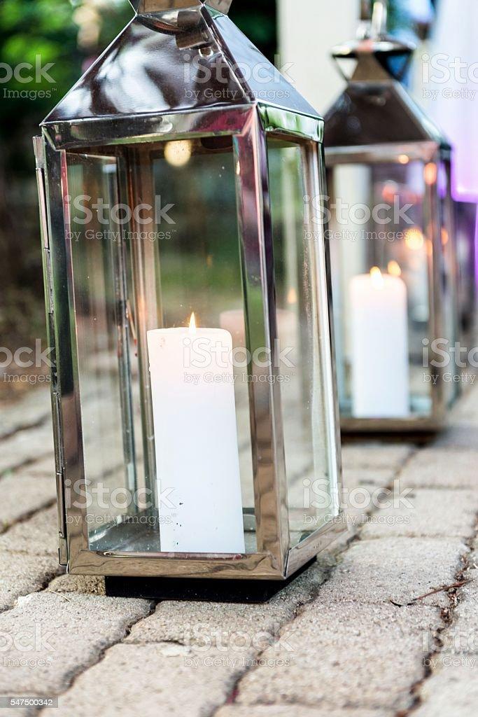 Shiny lanterns with candles stock photo