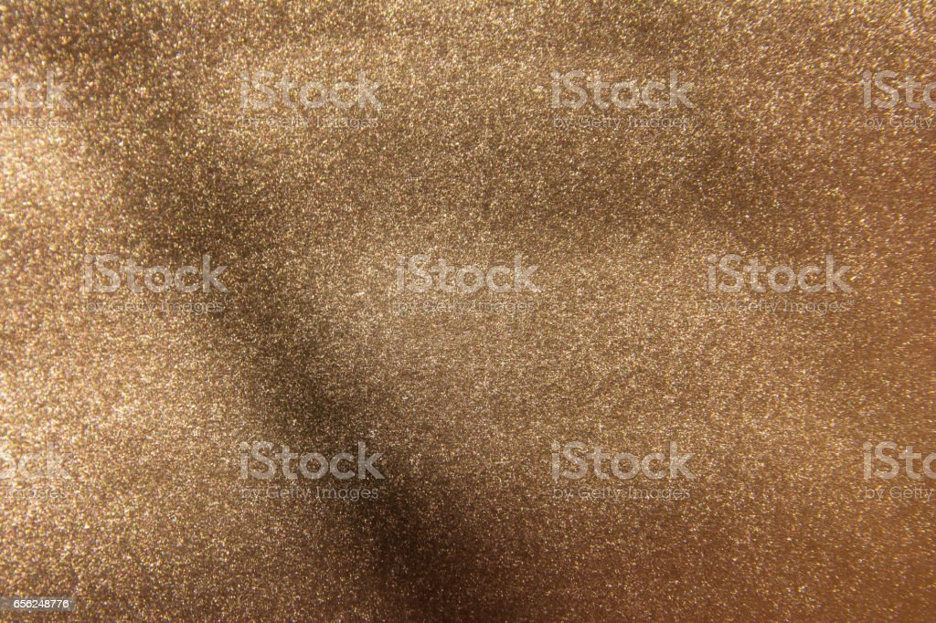 Shiny leaf gold foil texture background with shadow stock photo