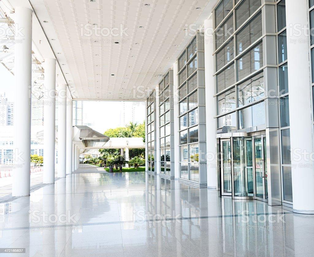 Shiny Modern Office Lobby With A Revolving Door stock photo
