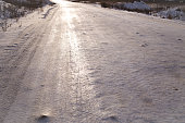 Shiny packed snow (icy) on a country road in winter