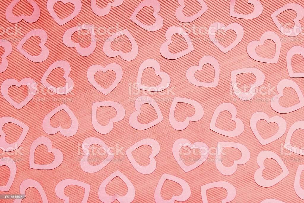 Shiny Pink Hearts on Textured Red Background royalty-free stock photo