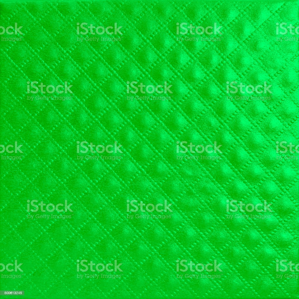 Shiny quilted green colour paper leather texture for Christmas royalty-free stock photo
