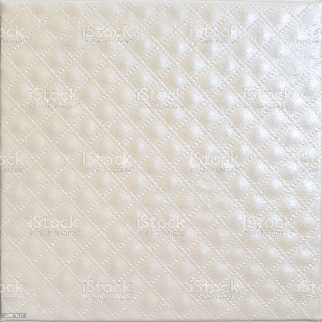 Shiny quilted pearl colour paper leather texture stock photo