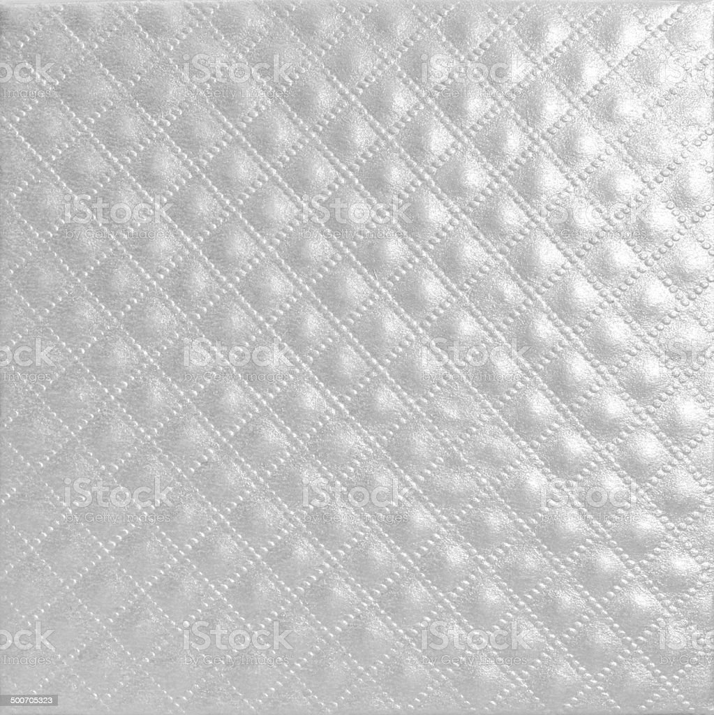 Shiny quilted silver paper leather texture stock photo
