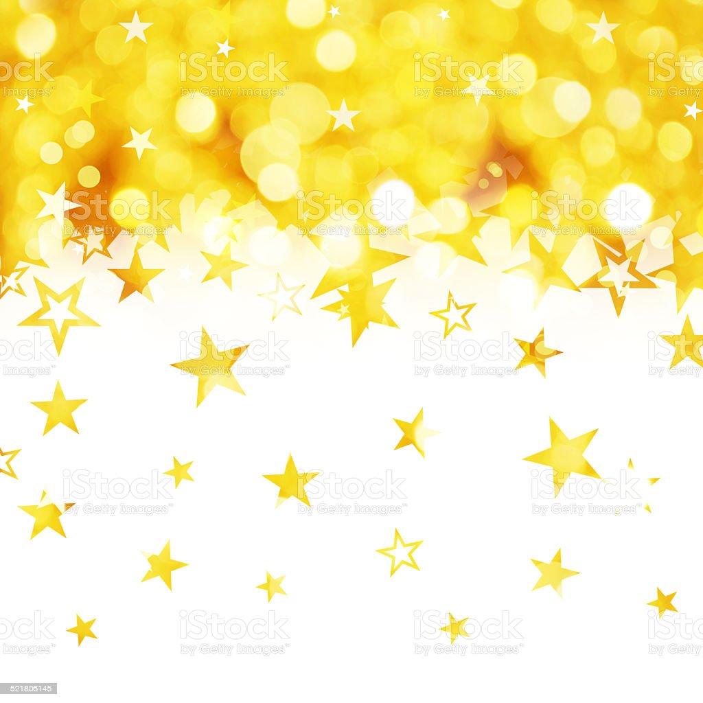Shiny rain of golden stars isolated on white background stock photo