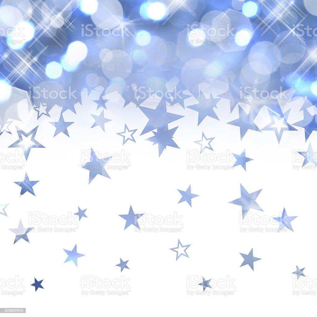 Shiny rain of pastel blue stars isolated on white background stock photo