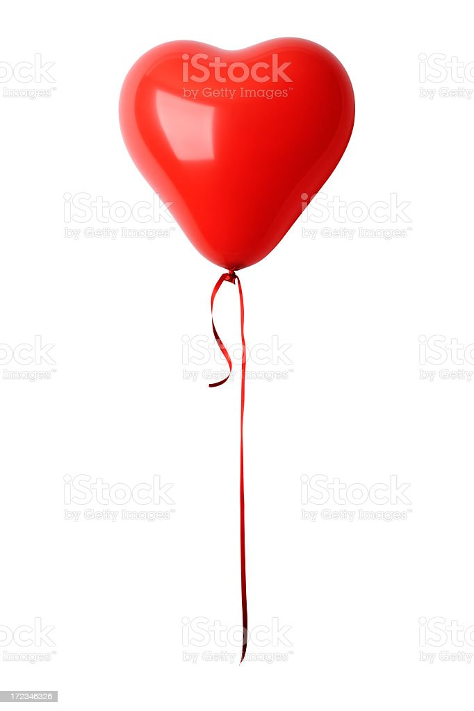 Shiny red heart shape balloon with ribbon against white background stock photo