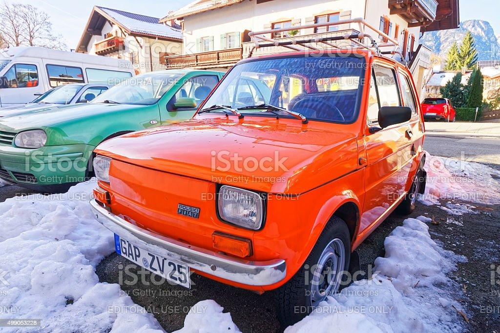 Shiny red Polski FIAT car parked in the street stock photo