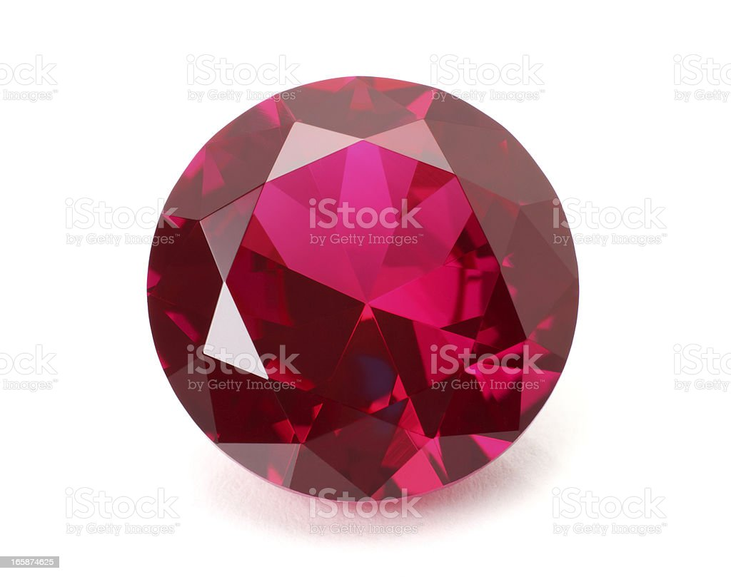 A shiny red ruby gemstone on a white background stock photo