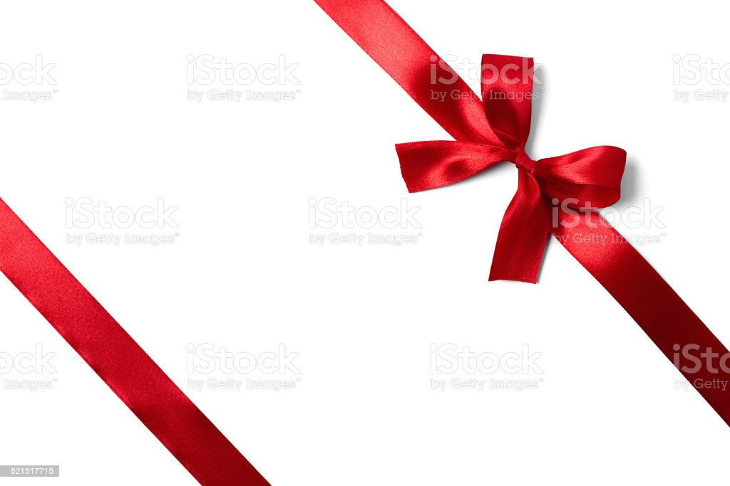 Shiny red satin ribbon on white background stock photo