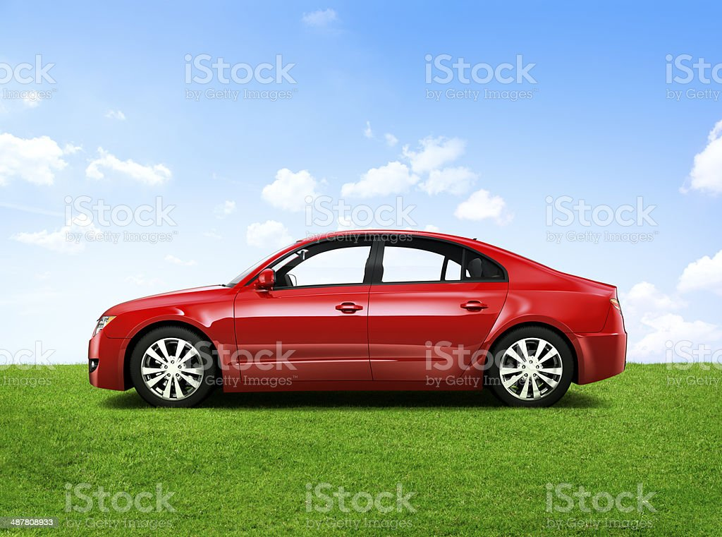 Shiny Red Sedan In The Outdoors stock photo