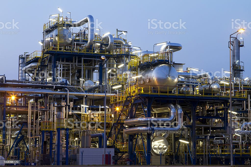 Shiny refinery operation at dusk stock photo