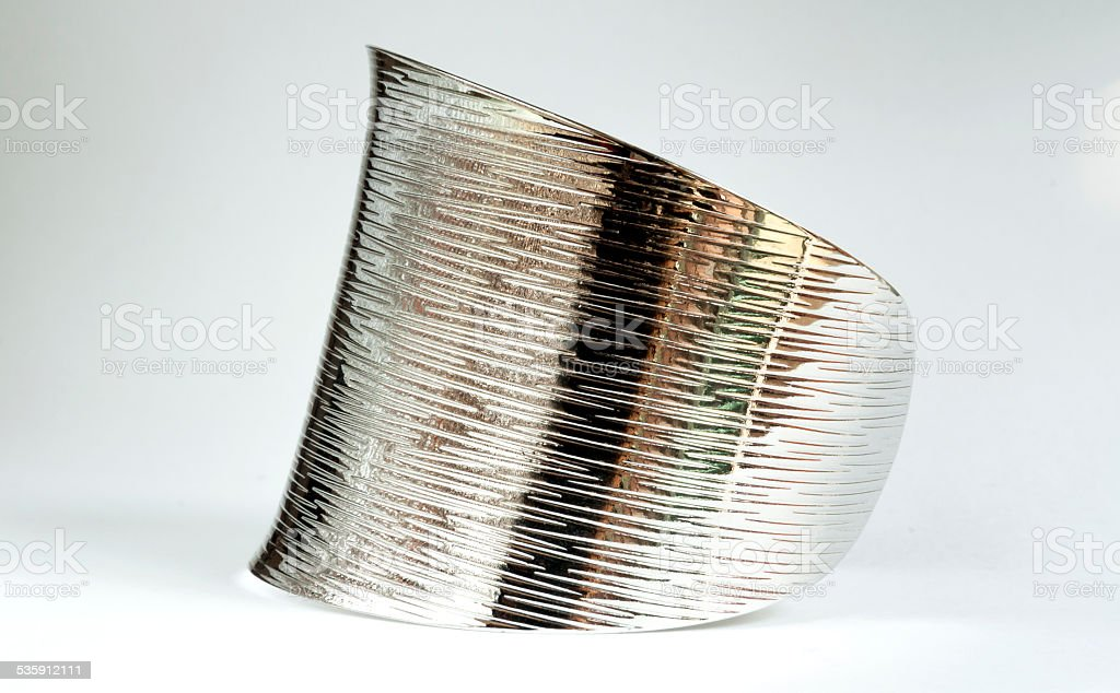 shiny silver bracelet from the side view royalty-free stock photo