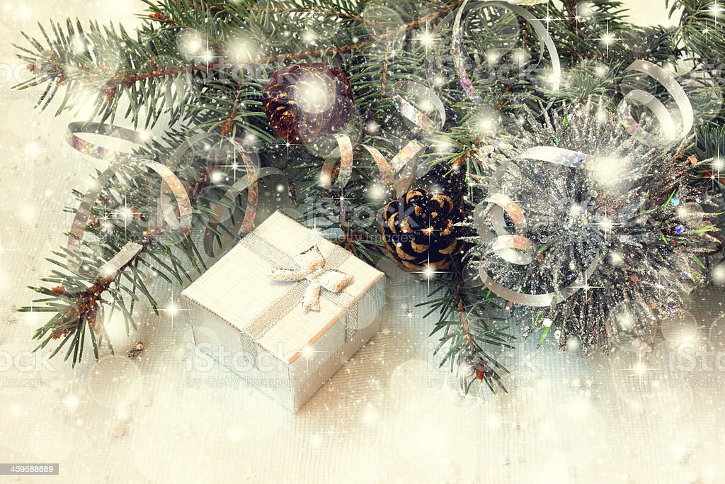 shiny silver gift box and christmas tree branches stock photo