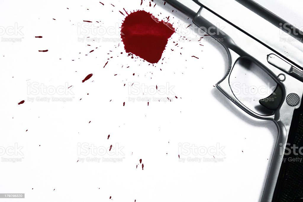 Shiny silver gun with 1 red blood drop royalty-free stock photo