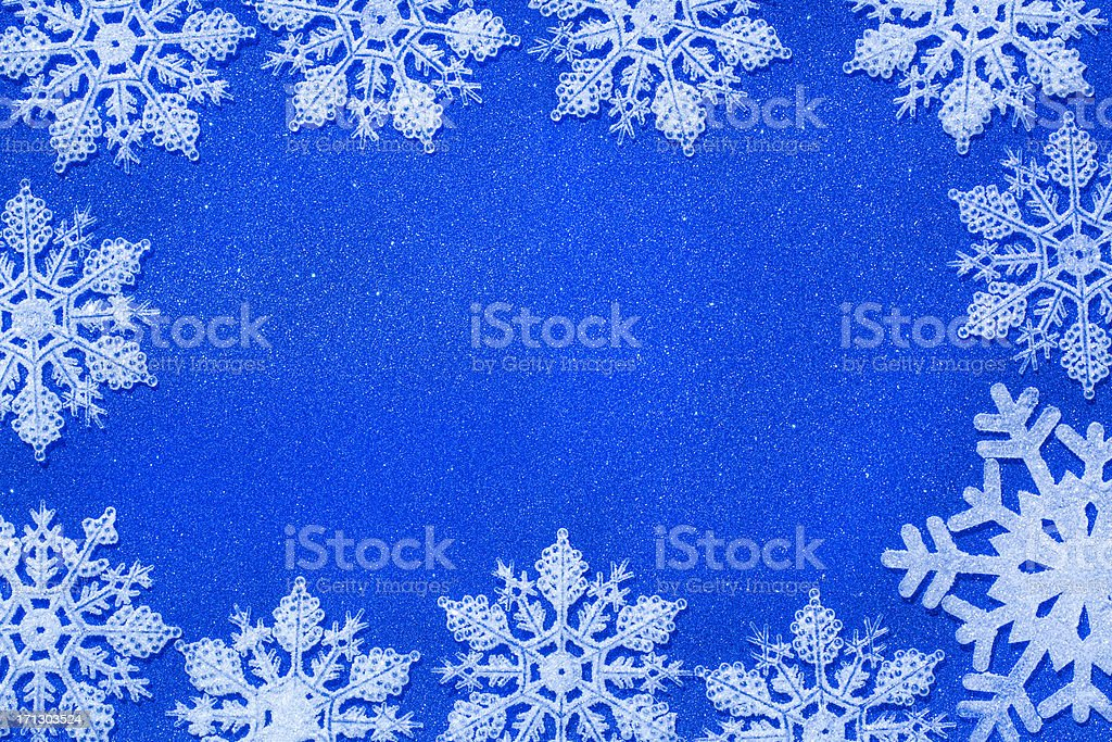 shiny snowflakes on blue christmas glitter background forming frame royalty-free stock photo